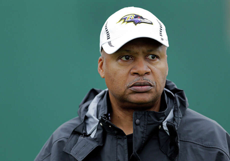 FILE - In this Jan. 30, 2013, file photo, Baltimore Ravens offensive coordinator Jim Caldwell walks onto the field as his team warms up during an NFL Super Bowl XLVII football practice in New Orleans. A person familiar with the situation says the Detroit Lions have hired coach Caldwell. (AP Photo/Patrick Semansky, File) / AP