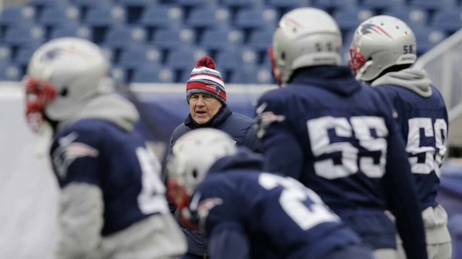 New England Patriots head coach Bill Belichick, rear, calls to his players during NFL football practice at Gillette Stadium in Foxborough, Mass., Wednesday, Jan. 14, 2015. The Patriots face the Indianapolis Colts in the AFC Championship game on Sunday. (AP Photo/Charles Krupa)