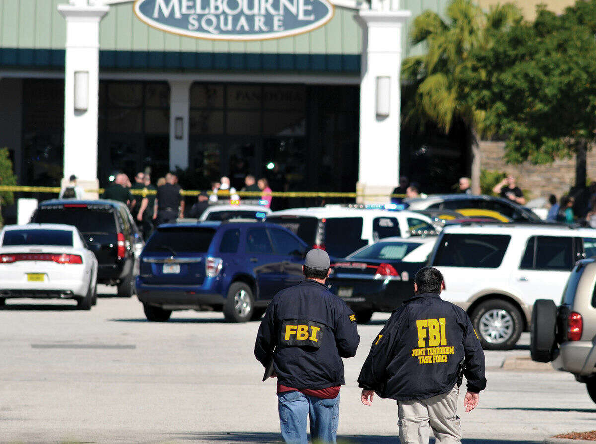 Law enforcement including the FBI respond to the scene of a shooting at the Melbourne Square Mall on Saturday, Jan 17, 2015 in Melbourne, Fla. Melbourne Police have confirmed that the shooting Saturday morning at the mall has left two people dead and one injured from a gunshot wound. Police say the injured victim is hospitalized in stable condition and cooperating with investigators. After responding to reports around 9:30 a.m. of multiple shots fired inside the mall, police tweeted that the