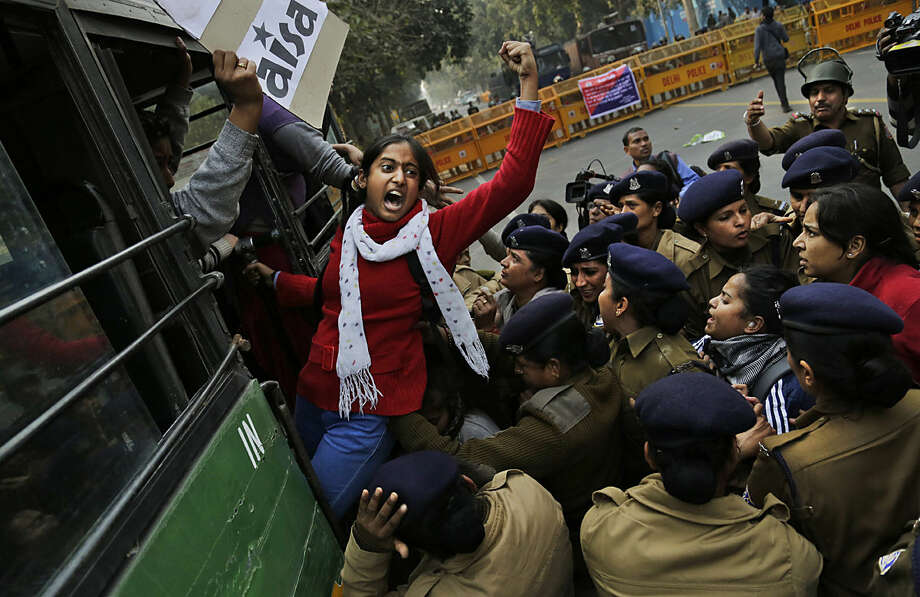 An Indian student shouts slogans demanding resignation of Indian education minister as she is detained by police during a protest against the death of student Rohith Vemula in New Delhi, India, Wednesday, Jan. 27, 2016. The students were protesting the death of Vemula, who, along with 4 others, was barred from using some facilities at his university in the southern tech-hub of Hyderabad. The protesters accused Hyderabad University's vice chancellor along with two federal ministers of unfairly demanding punishment for the five lower-caste students after they clashed last year with a group of students supporting the governing Hindu nationalist party. (AP Photo/Altaf Qadri)