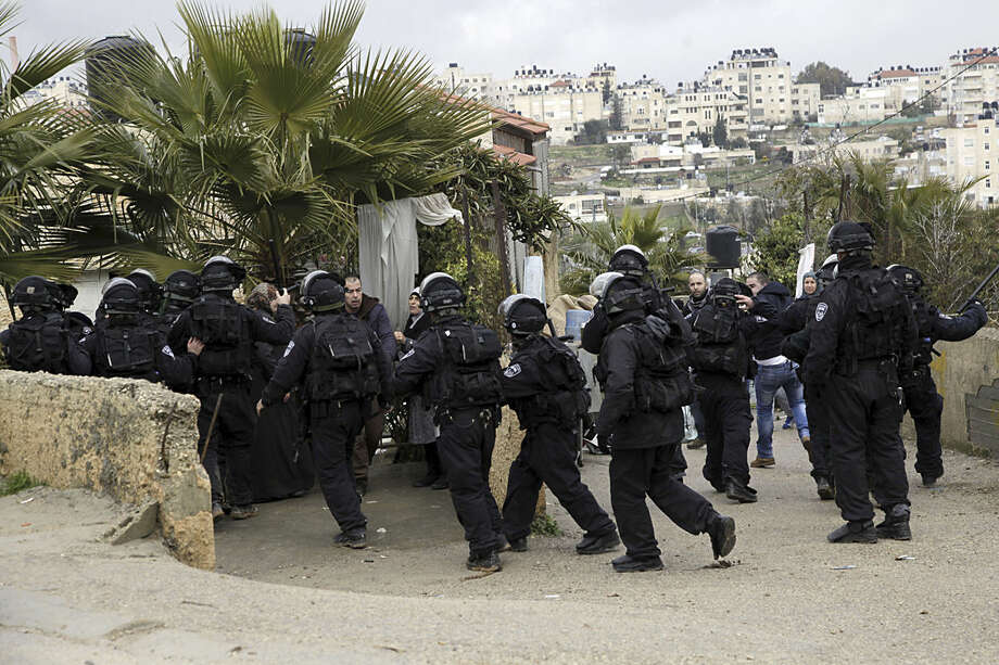 Israeli police enters a Palestinian family compound before a house demolition in Jerusalem, Wednesday, Jan. 27, 2016. The house was built without a permit, police said. (AP Photo/Mahmoud Illean)