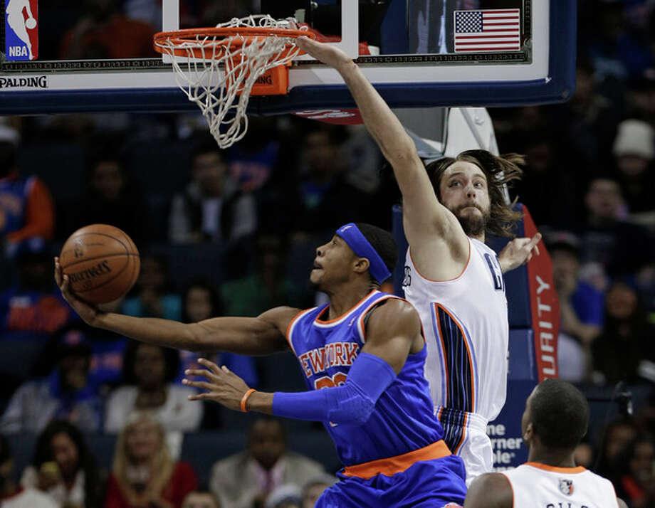 New York Knicks' Toure' Murry, front, drives past Charlotte Bobcats' Josh McRoberts during the first half of an NBA basketball game in Charlotte, N.C., Tuesday, Jan. 14, 2014. (AP Photo/Chuck Burton) / AP