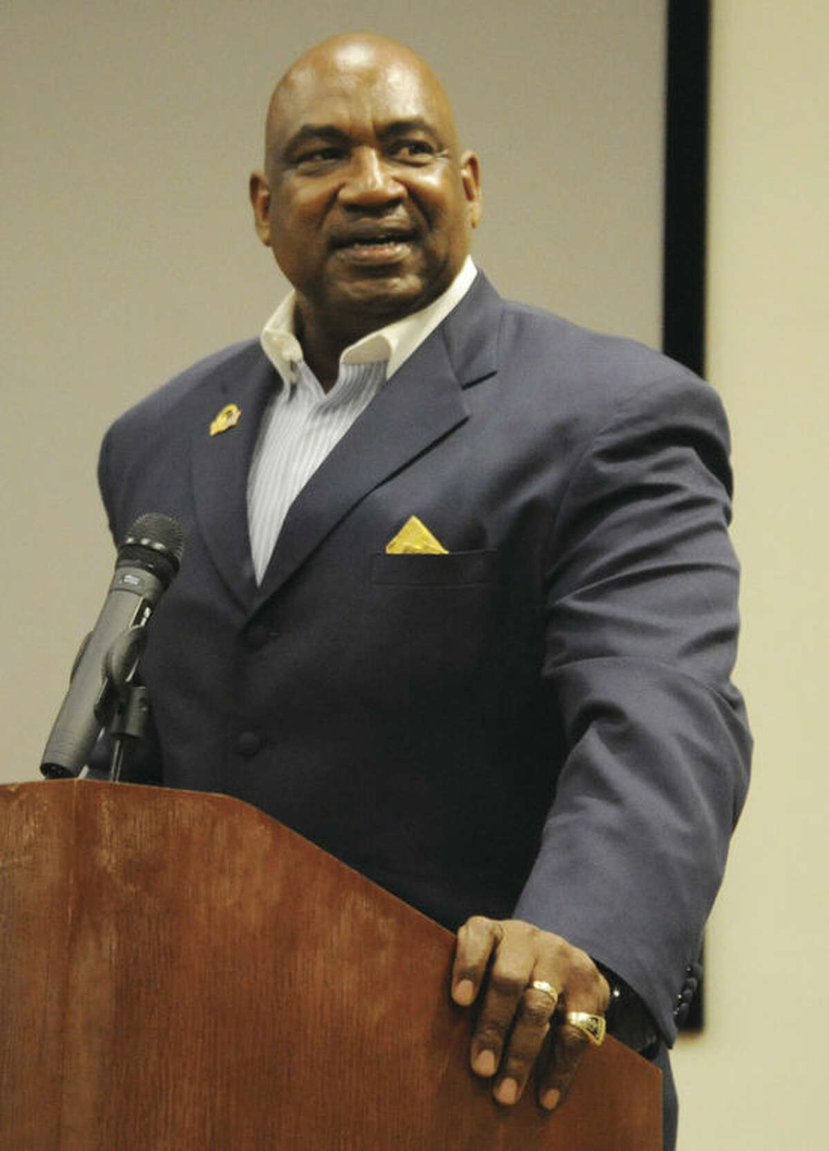 Hour photo/Matthew Vinci George Martin, a former defensive lineman for the New York Giants, addresses the crowd Tuesday night during his talk about civility on the gridiron at Stamford's Ferguson Library. Martin spent 14 years in the NFL, all with the Giants.