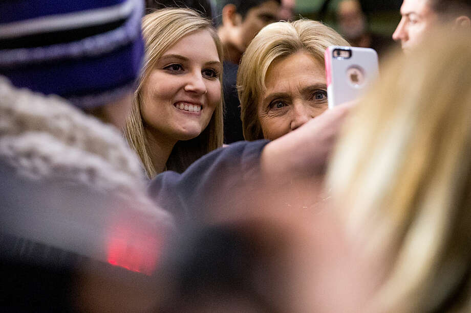 Democratic presidential candidate Hillary Clinton takes a photo with a member of the audience after speaking at a rally at Gallagher Bluedorn Performing Arts Center University of Northern Iowa in Cedar Falls, Iowa, Tuesday, Jan. 26, 2016. (AP Photo/Andrew Harnik)