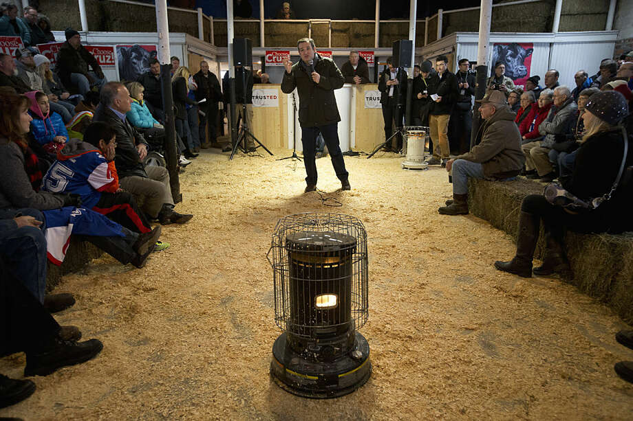 A space heater stands in front of supporters as Republican presidential candidate, Sen. Ted Cruz, R-Texas speaks at a campaign event at High Point Bulls Oswald Barn, Tuesday, Jan. 26, 2016, in Osceola, Iowa. (AP Photo/Jae C. Hong)