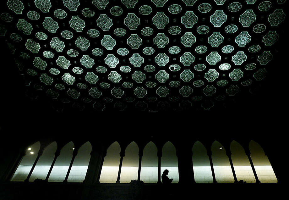 A person is silhouetted in the foyer of the House of Commons on Parliament Hill in Ottawa, Ontario, on Tuesday, Jan. 26, 2016. (Adrian Wyld /The Canadian Press via AP) MANDATORY CREDIT
