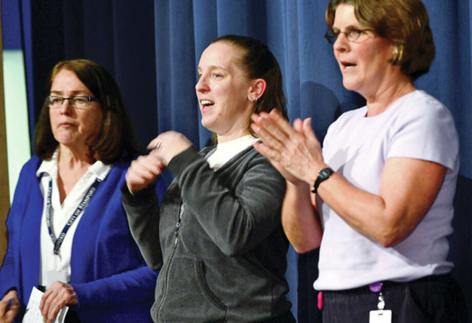 Hour photo / Erik Trautmann Rogers International School nurse Evon Malloy, physical education teachers Olga Herrera and Barbar Preli teach students how to wash their hands as Stamford's mayor David Martin visits the school to help kick off the district's increased efforts to prevent the flu and promote student wellness. Martin helped kick off the Clean Fins for all Terrapins poster contest, which the school is using to help promote respiratory etiquette and frequent hand washing with an assembly for 1st and 2nd grade students for the launch event Tuesday. / (C)2013, The Hour Newspapers, all rights reserved
