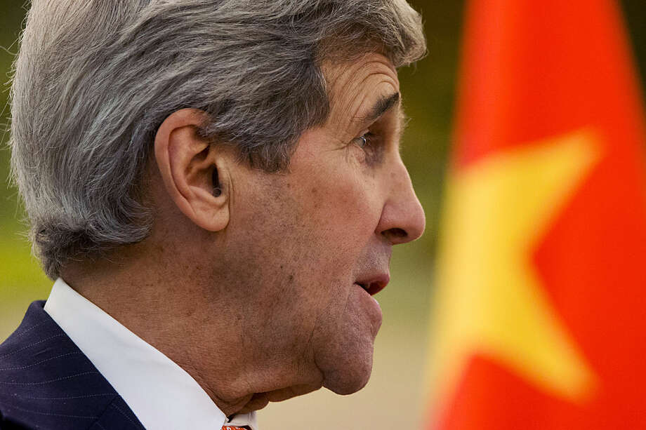 U.S. Secretary of State John Kerry speaks during a news conference with Chinese Foreign Minister Wang Yi at the Ministry of Foreign Affairs in Beijing, Wednesday, Jan. 27, 2016, on the final leg in Kerry's latest round-the-world diplomatic mission. (AP Photo/Jacquelyn Martin, Pool)