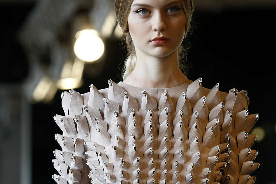 A model wears a creation for Stephane Rolland's Spring-Summer 2016 Haute Couture fashion collection presented in Paris, Tuesday, Jan. 26, 2016. (AP Photo/Francois Mori)