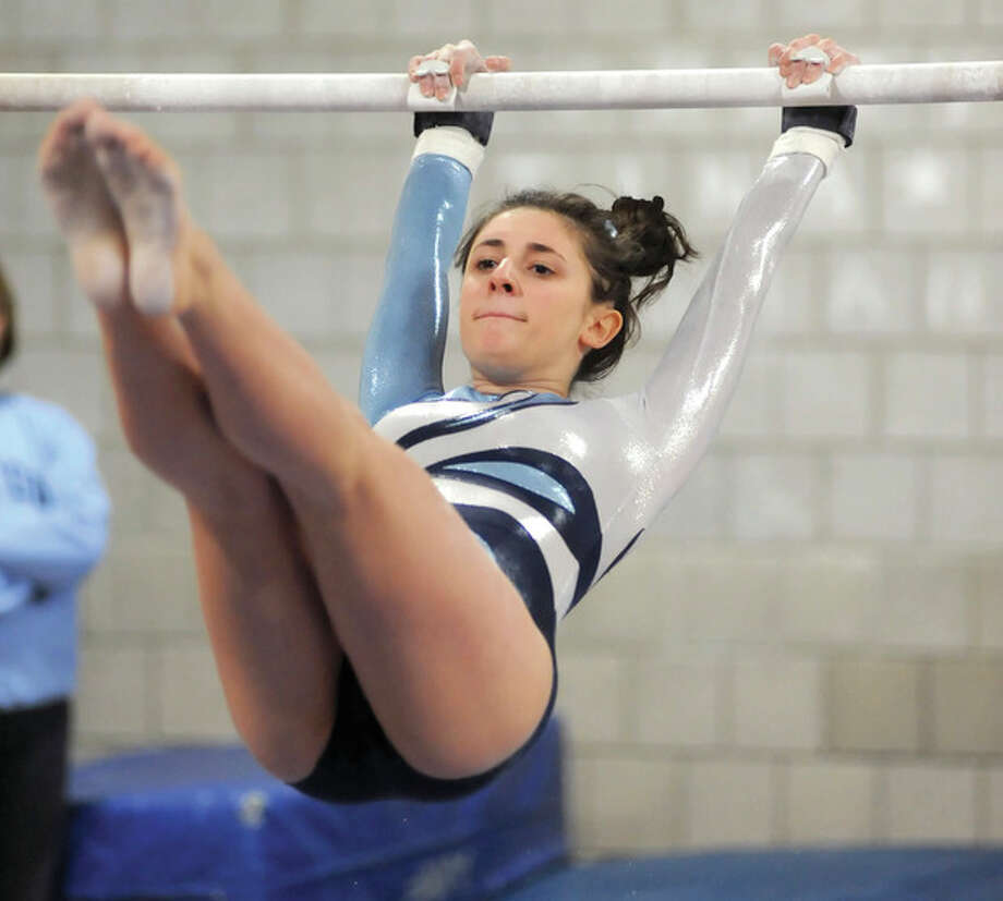 Hour photo/John NashWilton senior gymnast Annie Saltarelli performs on the balance beam during Tuesday's season-opening meet against Darien at Wilton High School.