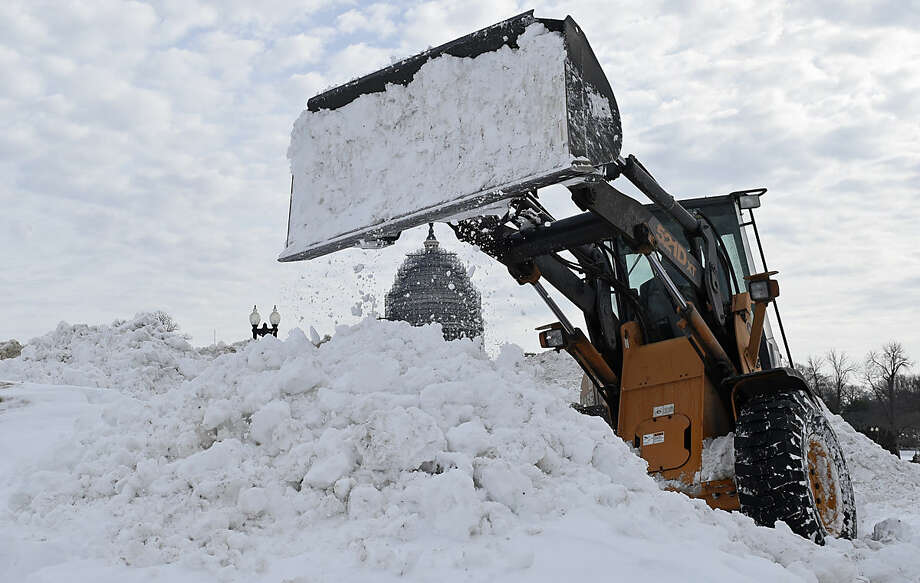 Snow is piled up near Capitol Hill in Washington, Tuesday, Jan. 26, 2016, as the nation's Capital tries to dig out following a massive snowstorm over the weekend. After more than three days with life at a virtual standstill in the nation's capital and elsewhere up and down the East Coast, the cities hit hard by a massive snowstorm were getting closer to their normal routines. (AP Photo/Susan Walsh)