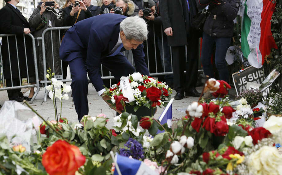 U.S. Secretary of State John Kerry lays a bouquet of flowers at a memorial site after the terrorist attacks in Paris, Friday, Jan. 16, 2015. U.S. Secretary of State John Kerry paid his respects Friday to the victims of last week's terrorist attacks in Paris in a show of American solidarity with the French people. (AP Photo/Rick Wilking, Pool)