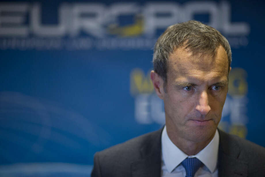 The head of the European police agency, Europol, Rob Wainwright, listens to questions during an interview in The Hague, Netherlands, Friday, Jan. 16, 2015. French and German authorities arrested at least 12 people Friday suspected of links to the Islamic State group and a Paris train station was evacuated, with Europe on alert for new potential terrorist attacks. The police raids came the morning after Belgian authorities moved swiftly to pre-empt what they called a major impending attack, killing two suspects in a firefight and arresting a third in a vast anti-terrorism sweep that stretched into the night. (AP Photo/Peter Dejong)