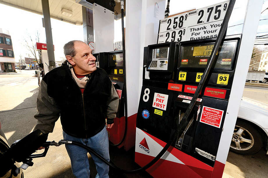Hour photo / Erik Trautmann Stamford resident Bobby Granelli gases up at the Citgo station on Hope St which has some of the lowest prices in the area.
