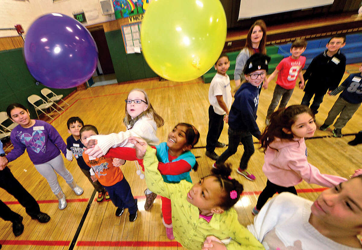 Hour photo / Erik Trautmann Columbus Magnet School students including Gemma Warde, Apoorva Diviti and India Richards particpate in the school's annual Peace Games Friday during a special assembly with the theme, These Hands, to honor the work and memory of Dr. Martin Luther King, Jr.