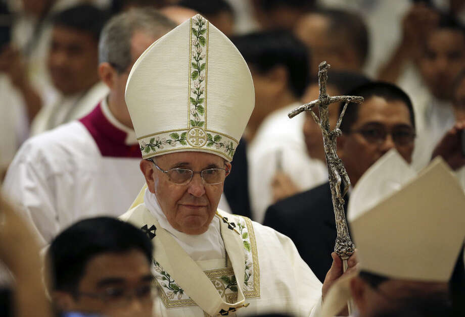 Pope Francis arrives for a Mass for the clergy and religious at the Cathedral Basilica of the Immaculate Conception during his visit in Manila, Philippines on Friday, Jan. 16, 2015. (AP Photo/Aaron Favila)