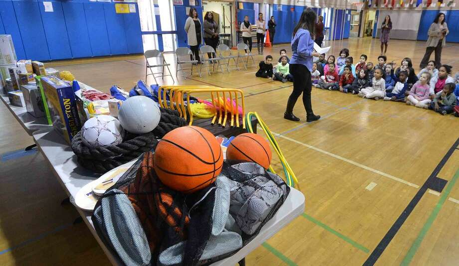 Hour Photo/Alex von Kleydorff A table full of exercise equipment, basketballs and volleyballs and healthy food options at Silvermine School for the Fit Kids after school program.