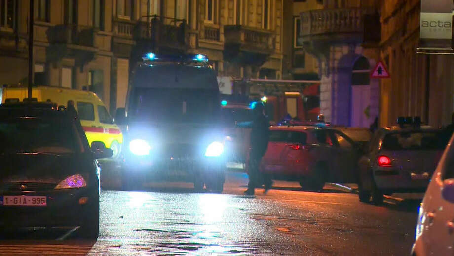 In this image made from video, police and emergency response vehicles block a street after security forces took part in anti-terrorist raids in Verviers, eastern Belgium. Belgian authorities say two people have been killed and one has been arrested during a shootout in an anti-terrorist operation in the eastern city of Verviers. (AP Photo/RTL - TVI) BELGIUM OUT