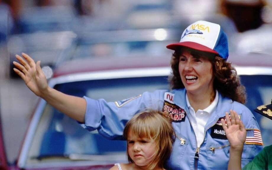 In this 1985 photo, high school teacher Christa McAuliffe rides with her daughter Caroline during a parade down Main Street in Concord, N.H. McAuliffe was one of seven crew members killed in the Space Shuttle Challenger explosion on Jan. 28, 1986. (AP Photo/Jim Cole)