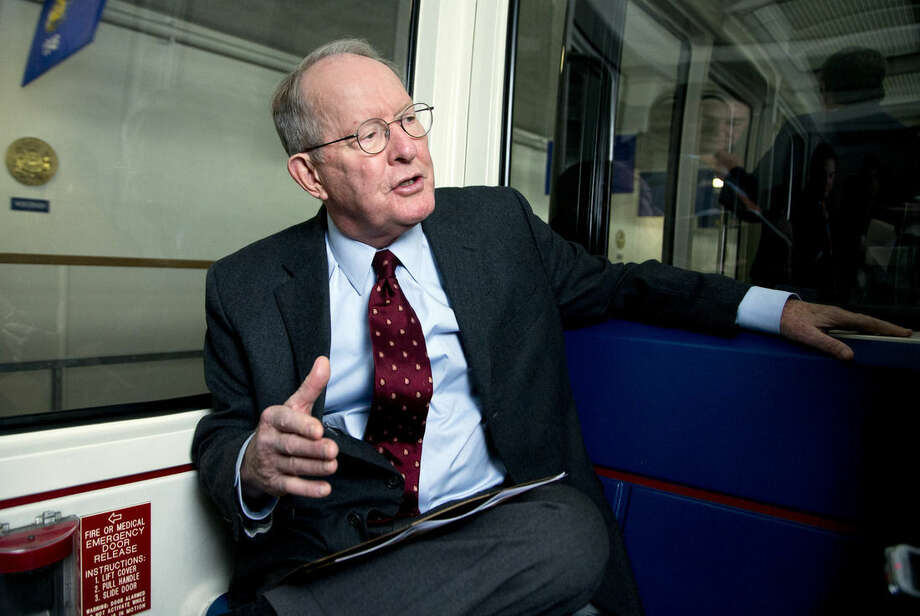 FILE - In this Nov. 14, 2014 file photo, Sen. Lamar Alexander, R-Tenn. speaks as he rides the subway from the U.S. Capitol to his office at the Dirksen Senate office building on Capitol Hill in Washington. Do students take too many tests? Amid complaints of a high stakes testing culture in classrooms, some states are reviewing the quality and quantity of the tests their students take. Congress is also getting into the act. On Wednesday, the Senate education committee takes up the issue of whether federally mandated annual testing should remain a requirement under No Child Left Behind as it addresses the reauthorization of the bipartisan education bill President George W. Bush signed into law in 2002. (AP Photo/Manuel Balce Ceneta, File)