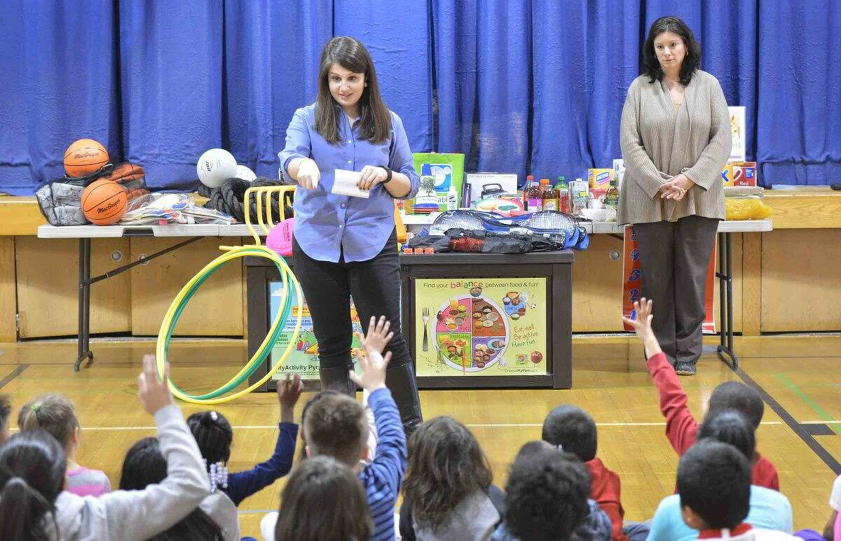 Hour Photo/Alex von Kleydorff Kaitlin Latham, Health Education Associate with the City of Norwalk Health Department, talks to kids at Silvermine School about the new health and fitness items for the Fit Kids after school program.