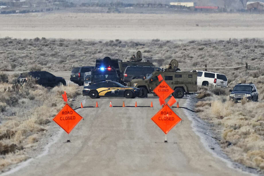 Thomas Boyd/The Oregonian via APLaw enforcement personnel block an access road to the Malheur National Wildlife Refuge, Wednesday, Jan. 27, near Burns, Ore. Authorities were restricting access on Wednesday to the Oregon refuge being occupied by an armed group after one of the occupiers was killed during a traffic stop and eight more, including the group's leader Ammon Bundy, were arrested.