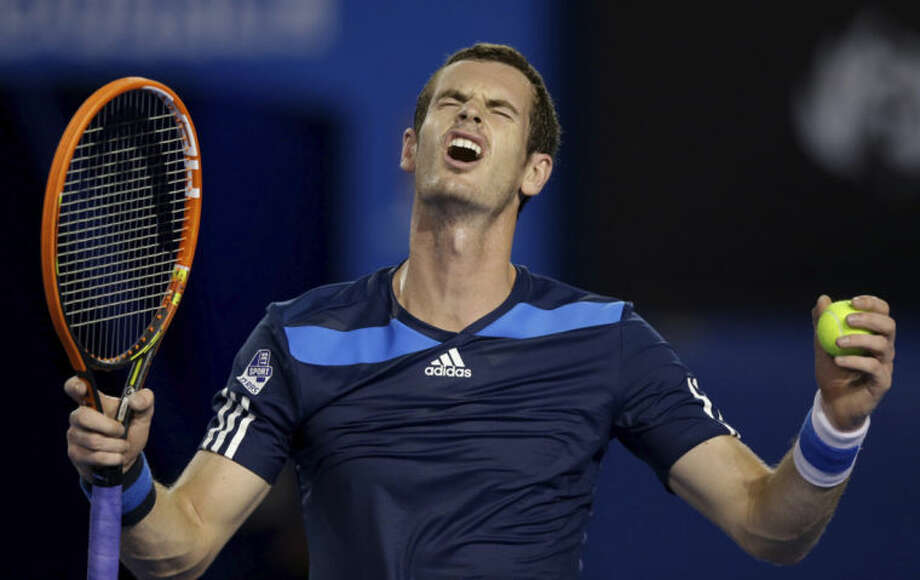 Andy Murray of Britain reacts during his second round match against Vincent Millot of France at the Australian Open tennis championship in Melbourne, Australia, Thursday, Jan. 16, 2014.(AP Photo/Aaron Favila)