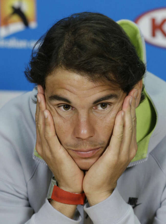 Spain's Rafael Nadal listens to a question during a press conference ahead of the Australian Open tennis championship in Melbourne, Australia, Saturday, Jan. 17, 2015. (AP Photo/Lee Jin-man)