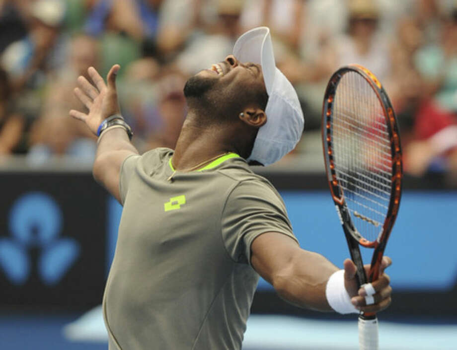 Donald Young of the U.S. celebrates after defeating Andreas Seppi of Italy in their second round match at the Australian Open tennis championship in Melbourne, Australia, Thursday, Jan. 16, 2014. (AP Photo/Andrew Brownbill)