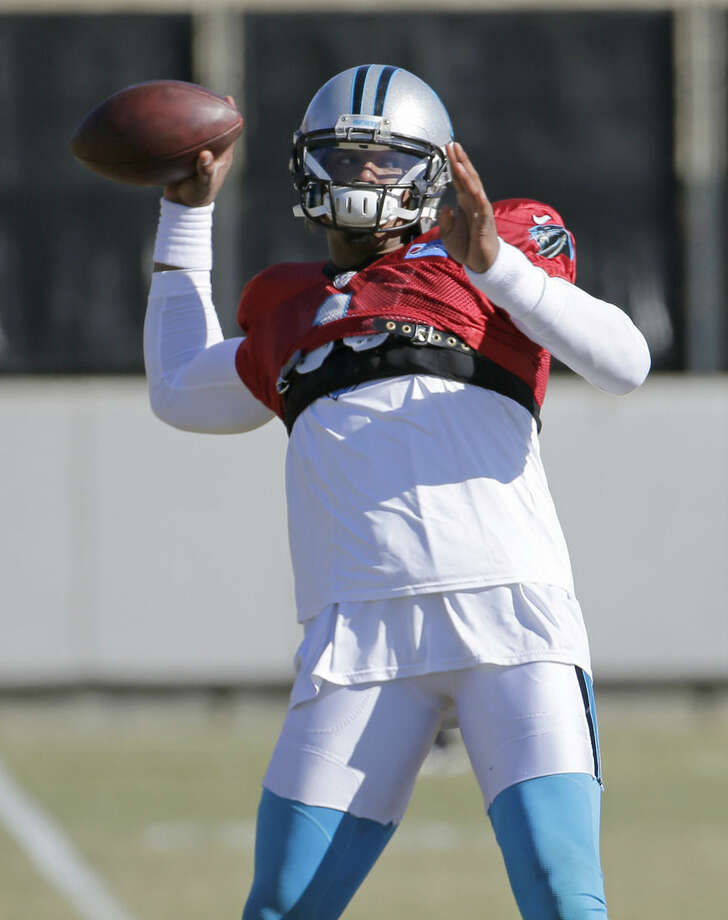 Carolina Panthers' Cam Newton throws a pass during NFL football practice, Friday, Jan. 29, 2016, in Charlotte, N.C. (AP Photo/Chuck Burton)
