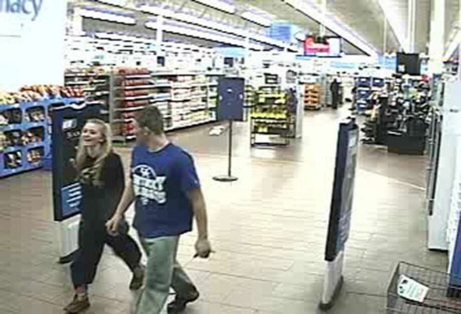 In this January 2015 photo made from surveillance video and released by the Grayson County Sheriff's Office, in Kentucky, 18-year-old Dalton Hayes and 13-year-old Cheyenne Phillips leave a South Carolina Wal-Mart. Authorities are looking for the teenage couple from central Kentucky who are suspected in a multistate crime spree. (AP Photo/Wal-Mart Inc. via The Grayson County (Ky.) Sheriff's Office)