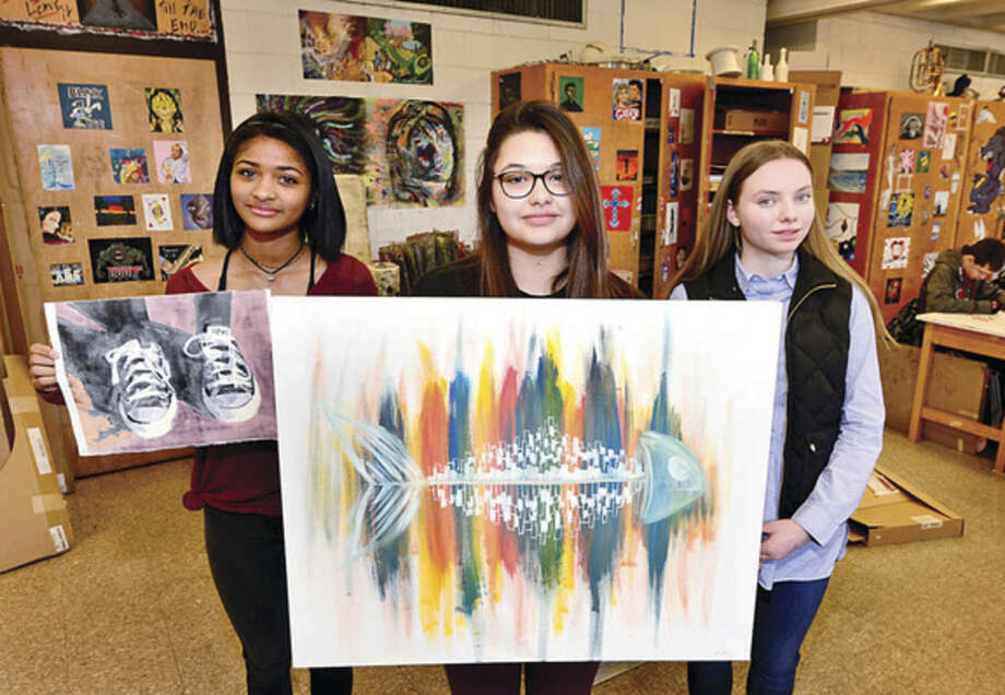 Hour photo/Erik TrautmannNorwalk High School 12th-grade art student Charlene Atkinson won a Gold Key Award in the 26th Annual Scholastic Art & Writing Contest, as did 12th-grader Nora Villalobos, who also won a Silver Key Award Award and several honorable mentions, and 10th-grader Megan Ruhnke, who won a Silver Key Award.