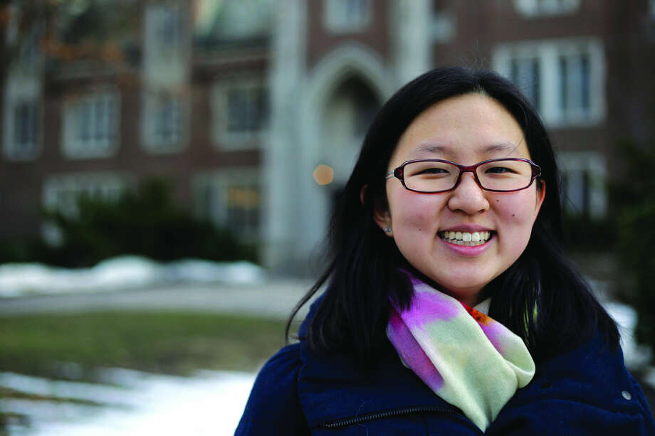 """Linda Liu, of Beijing, a freshman at Wellesley College, poses on campus, Wednesday, Jan. 27, 2016, in Wellesley, Mass. During her college application process, Liu utilized a recorded interview service called """"InitialView."""" American colleges sorting through record numbers of applications from China are turning increasingly to video-interviewing services to assess students' language skills, get a feel for their personality _ and weed out fraudsters. (AP Photo/Elise Amendola)"""