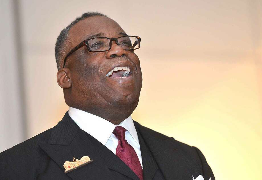 "Hour Photo/Alex von Kleydorff Memorial Message Speaker Rev. Dr. Tommie Jackson sings with others ""Lift every voice and sing"" during the Norwalk City-Wide Observance of the National Holiday Honoring Rev Dr. Martin Luther King Jr. at City hall Concert Hall"
