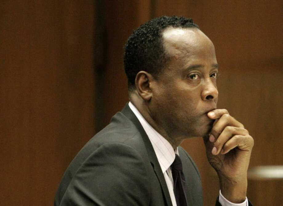 FILE - In this Friday, Oct. 21, 2011 file photo, Michael Jackson's former doctor Conrad Murray sits in a courtroom during his involuntary manslaughter trial in Los Angeles. A California appeals court in Los Angeles on Wednesday, Jan. 15, 2014, unanimously affirmed the involuntary manslaughter conviction of Murray. (AP Photo/Reed Saxon, Pool, File)