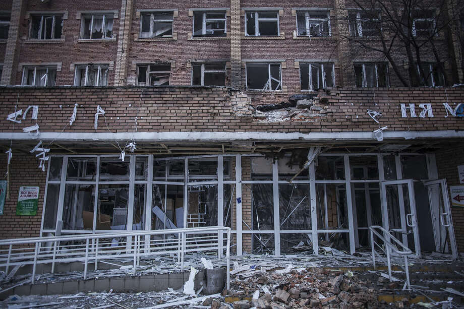 A view of the damaged Hospital Nº 3, after it was hit by Ukrainian Army artillery in Kalininsky district, in Donetsk, Ukraine. Monday, Jan. 19, 2015. The separatist stronghold, Donetsk, was shaken by intense outgoing and incoming artillery fire on Sunday as a bitter battle raged for control over the city's airport. Streets in the city, which was home to 1 million people before unrest erupted in spring, were completely deserted and the windows of apartments in the center rattled from incessant rocket and mortar fire. (AP Photo/Manu Brabo)