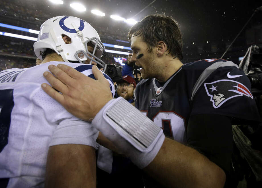 New England Patriots quarterback Tom Brady, right, speaks to Indianapolis Colts quarterback Andrew Luck after the NFL football AFC Championship game Sunday, Jan. 18, 2015, in Foxborough, Mass. The Patriots defeated the Colts 45-7 to advance to the Super Bowl against the Seattle Seahawks. (AP Photo/Matt Slocum)