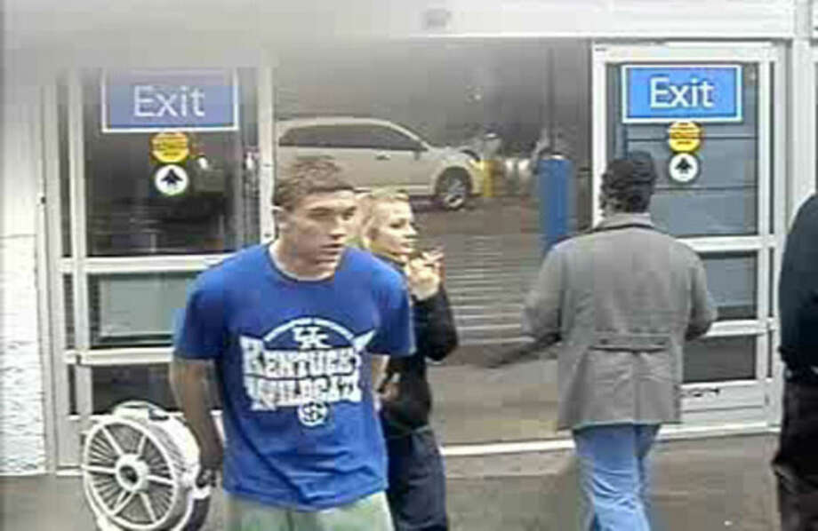 In this January 2015 photo made from surveillance video and released by the Grayson County Sheriff's Office, in Kentucky, 18-year-old Dalton Hayes and 13-year-old Cheyenne Phillips walk into a South Carolina Wal-Mart. Kentucky authorities say the two teenage sweethearts suspected in a crime spree of stolen vehicles and pilfered checks across the South have been apprehended in in Panama City Beach Florida early Sunday Jan. 18, 2015. (AP Photo/Wal-Mart Inc. via The Grayson County (Ky.) Sheriff's Office)