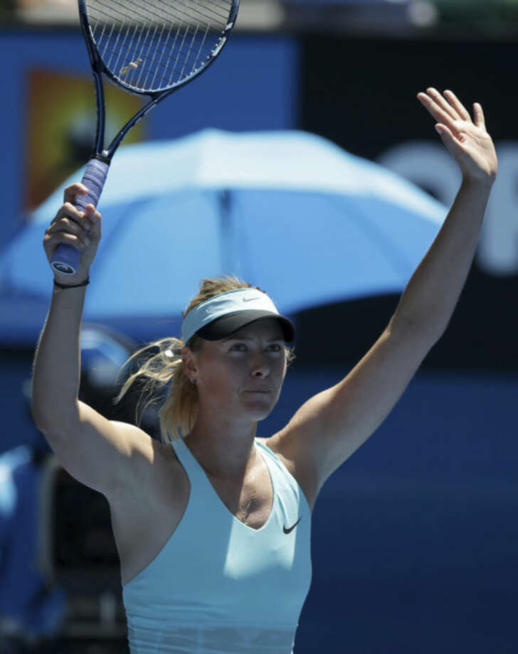 Maria Sharapova of Russia celebrates after defeating Karin Knapp of Italy during their second round match at the Australian Open tennis championship in Melbourne, Australia, Thursday, Jan. 16, 2014.(AP Photo/Aaron Favila)