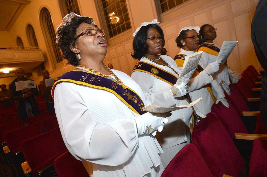 Hour Photo/Alex von Kleydorff Members of the Corinthian Lodge #16, Deborah Chapter #21, Order of The Eastern Star Prince Hall in Norwalk sing with others gathered for the City-Wide Observance of the National Holiday Honoring Rev Dr. Martin Luther King Jr.