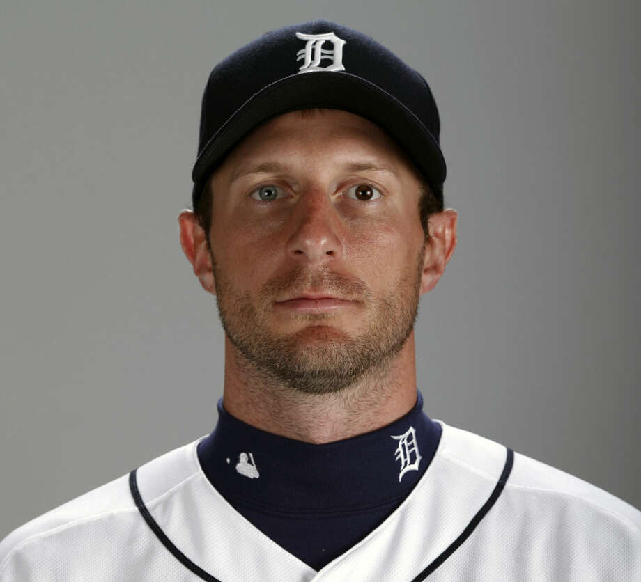 FILE - This 2014, file photo shows Max Scherzer of the Detroit Tigers baseball team. Max Scherzer will become the highest-paid right-handed pitcher in the major leagues after agreeing to a $210 million, seven-year contract with the Washington Nationals that includes a record $50 million signing bonus. A person familiar with the negotiations outlined the terms to The Associated Press on Monday, Jan. 19, 2015, speaking on condition of anonymity because the deal hadn't been announced. (AP Photo/Gene J. Puskar, File)