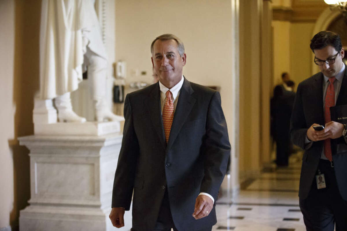 House Speaker John Boehner of Ohio leaves the House chamber on Capitol Hill in Washington, Wednesday, Jan. 15, 2014, after the final vote on a massive $1.1 trillion spending bill. The measure sailed through the House with no suspense and little dissent ?- fueled additionally by lawmakers' desire to avoid an election-year replay of last fall's widely unpopular 16-day federal shutdown. (AP Photo/J. Scott Applewhite)
