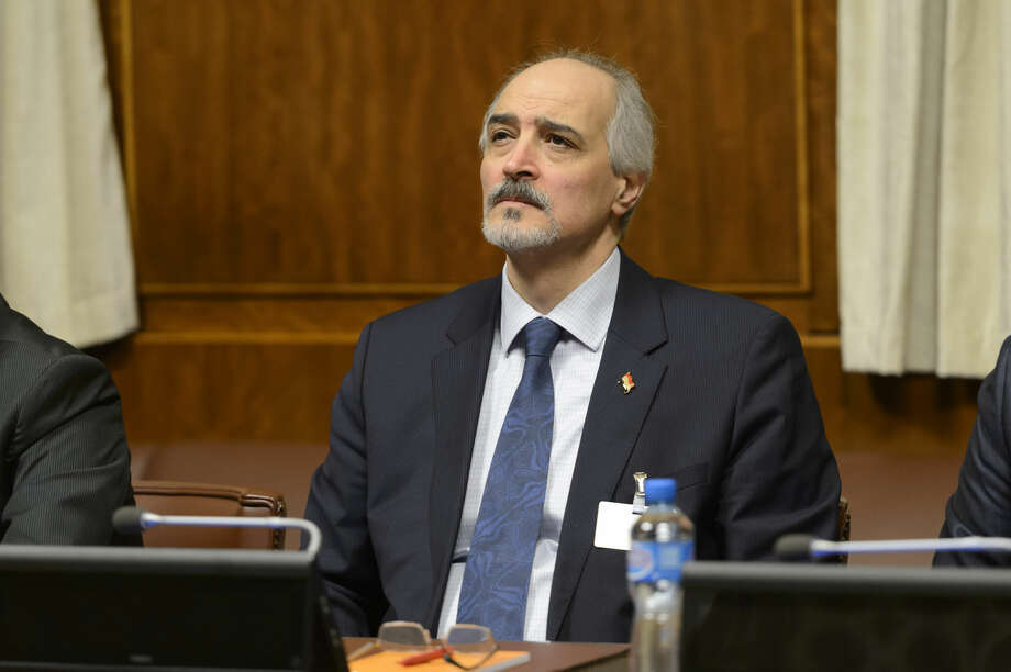 "Syrian chief negotiator Bashar al-Jaafari, Ambassador of the Permanent Representative Mission of the Syria to UN New York, sits after arriving for the round of negotiation between the Syrian government and the opposition in Geneva, Switzerland, Friday, Jan. 29, 2016. The United Nation's Syria envoy says he has ""good reason to believe"" that the main Syrian opposition group will join Geneva peace talks Sunday. Staffan de Mistura says he is still waiting for ""formal indication"" that the opposition coalition, known as the Higher Negotiating Committee, will attend the talks. (Martial Trezzini/Keystone via AP) SWITZERLAND OUT"