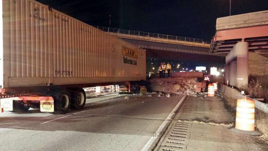 This photo provided by the Cincinnati Fire and EMS, shows the scene following a highway overpass collapse in Cincinnati, Monday, Jan. 19, 2015. The Cincinnati Enquirer reports that according to a police dispatch the southbound Interstate 75 was closed indefinitely after the collapse of the overpass. (AP Photo/Cincinnati Fire and EMS)