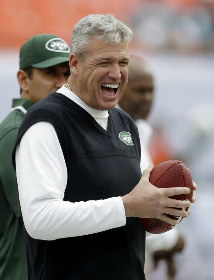 FILE - In this Dec. 29, 2013, file photo, New York Jets head coach Rex Ryan has a laugh on the sideline before an NFL football game against the Miami Dolphins in Miami Gardens, Fla. The Jets have signed Ryan to a contract extension, removing the lame duck label and keeping him with the franchise for at least the next two years.(AP Photo/Alan Diaz, File)