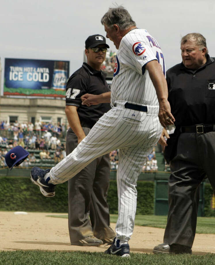 FILE - In this June 2, 2007, file photo, Chicago Cubs manager Lou Piniella, center, kicks his cap as he argues with third base umpire Mark Wegner, left, and home plate umpire Bruce Froemming watches during the eighth inning of a baseball game against Atlanta Braves in Chicago. Major League Baseball announced Thursday, Jan. 16, 2014, that owners, players and umpires have approved a new instant replay system to review close calls. (AP Photo/Nam Y. Huh, File)