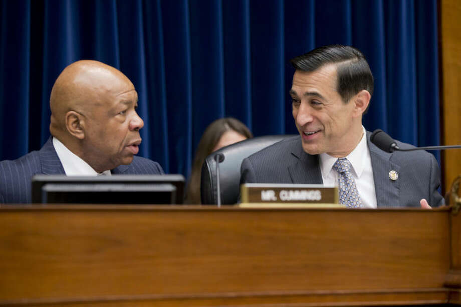 FILE - In this Dec. 4, 2013, file photo, House Oversight and Government Reform Committee Chairman Rep. Darrell Issa, R-Calif., right, confers with the committee's ranking Democrat, Rep. Elijah Cummings, D-Md., on Capitol Hill in Washington, before the start of the committee's hearing on the implementation of the Affordable Care Act's HealthCare.gov website. The top cybersecurity officer for the federal Health and Human Services department was concerned about potential vulnerabilities ahead of the launch of the Obama administration's health care website. Issa, investigating the chaotic rollout of the website contends the administration risked the personal information of millions of Americans in its zeal to meet a self-imposed Oct. 1 deadline. Cummings says the administration addressed the potential security issues through added vigilance instituted before the site went live. (AP Photo/J. Scott Applewhite, File)