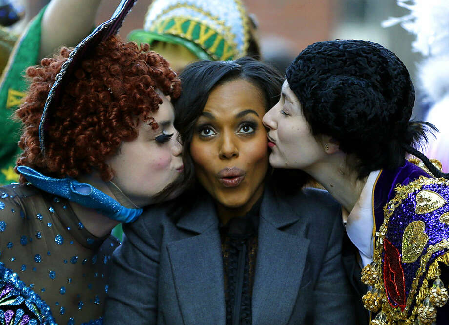Actress Kerry Washington, Harvard University's Hasty Pudding Theatricals' Woman of the Year, is kissed by actors in drag, Robert Fitzpatrick, left, and David Sheynberg, right, as she is paraded through the streets of Harvard Square, Thursday, Jan. 28, 2016, in Cambridge, Mass. (AP Photo/Elise Amendola)