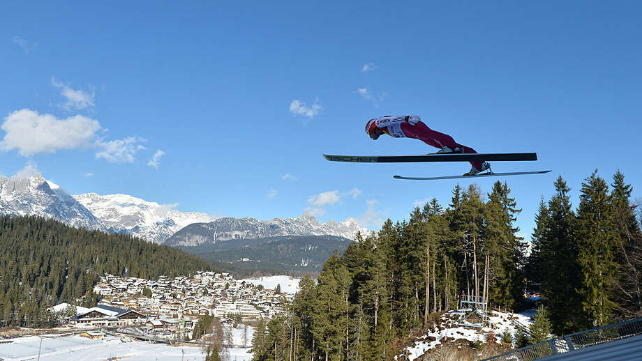 Germany's EricFrenzel soars through the air during the Nordic Combined World Cup competition in Seefeld, Austria, Friday, Jan. 29, 2016. (AP Photo/Kerstin Joensson)