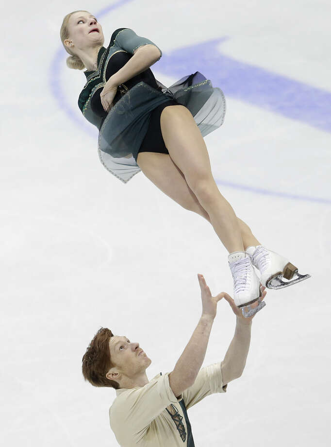 Evgenia Tarasova and Vladimir Morozov, of Russia, skate pair's short program at the European figure skating championships in Bratislava, Slovakia, on Friday, Jan. 29, 2016. (AP Photo/Petr David Josek)